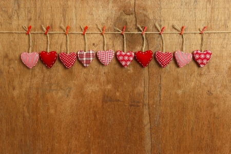 White Love Valentine s hearts hanging on wooden texture background photo