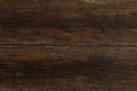 distressed wood: Two old dark brown planks of primitive driftwood texture with rough wood surface
