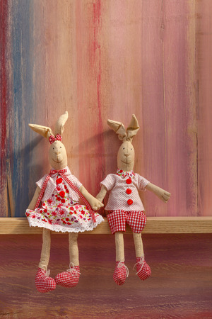 Rabbits in love cute wedding card invitation Valentines day with copy space on painted background Stock Photo
