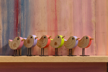 Happy easter singing wooden birch birds on painted background and copy space Stock Photo