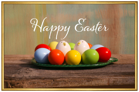 Happy easter text with painted eggs old  background golden frame
