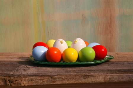 Happy easter painted eggs on green tray yellow green painted background copy space photo