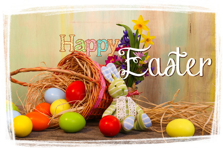 Happy easter text with painted eggs wicker basket old  background white frame photo