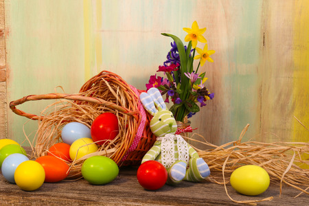 Happy easter text with bunny painted eggs wicker basket old  background copy space Stock Photo