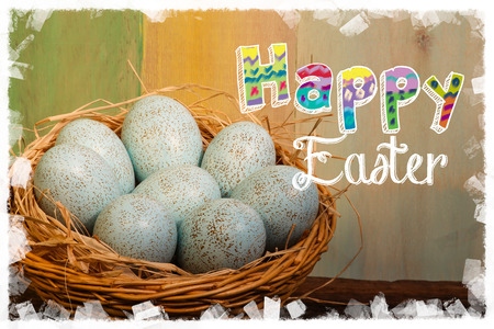 Happy easter text with painted duck eggs wicker basket old  background white frame photo