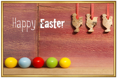 Happy easter text with painted eggs three cocks on gingham ribbons old red background golden frame photo