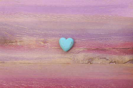 Love message space on colorful painted board with blue wooden heart and copy space Stock Photo