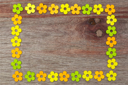Square shaped love painted flowers Valentines day old vintage wooden table and copy space