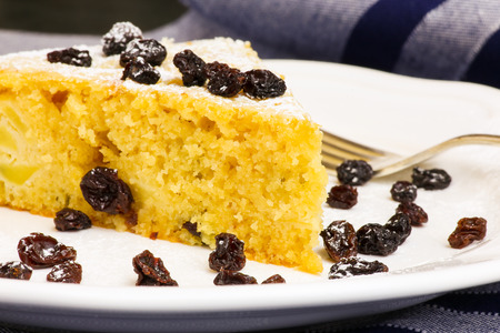 black currants: Apple vanilla ginger cake with black currants on white plate and silver fork striped tablecloth