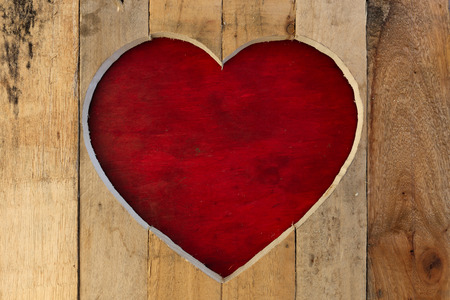 Love Valentines heart wooden frame from recycled old palette with red board background, copy space