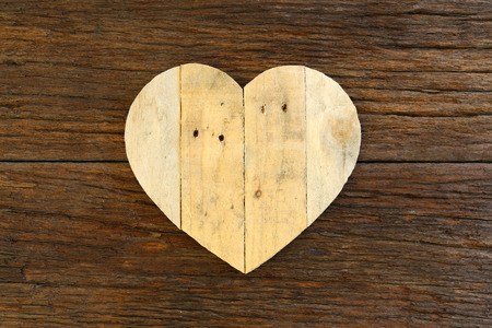 Love Valentines wooden heart from recycled old palette on rough driftwood background, copy space photo