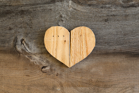Love Valentines wooden heart from recycled old palette on old grey  Stock Photo