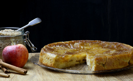 afternoon fancy cake: Caramelised apple tarte tart tartin fancy cake pie on glass plate slice cut off on saple table