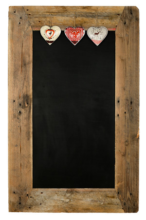 Chalkboard christmas restaurant menu board reclaimed pallet wooden frame and shabby chic tin heart decoration, isolated on white with copy space photo