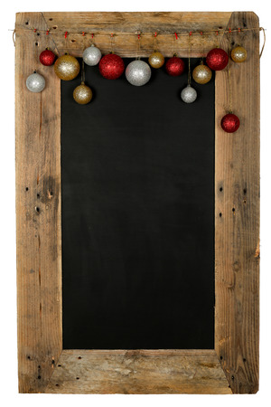 Chalkboard christmas restaurant menu board reclaimed pallet wooden frame and hanging xmas balls, isolated on white with copy space