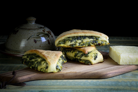 Yeast dough rolls strudel with swiss chard and spinach and cheddar parmesan cheese