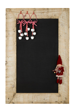 Merry Christmas and Happy New Years chalkboard blackboard tin bells and puppet decoration restaurant vintage menu design on painted reclaimed wooden frame isolated on white with copy space