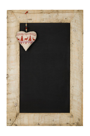 Merry Christmas and Happy New Years chalkboard blackboard heart decoration restaurant vintage menu design on painted reclaimed wooden frame isolated on white with copy space