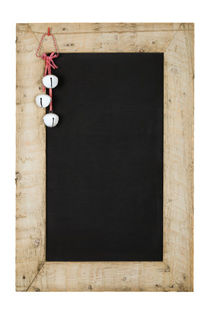 Merry Christmas and Happy New Years chalkboard blackboard tin bells decoration restaurant vintage menu design on painted reclaimed wooden frame isolated on white with copy space Stock Photo