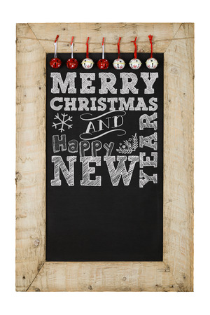 reclaimed: Merry Christmas and Happy New Years chalkboard blackboard bells decoration restaurant vintage menu design on painted reclaimed wooden frame isolated on white with copy space