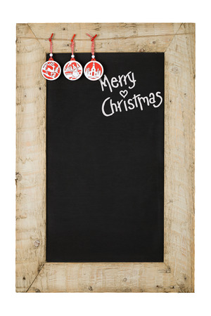 Merry Christmas and Happy New Years chalkboard blackboard hangers decoration restaurant vintage menu design on painted reclaimed wooden frame isolated on white with copy space