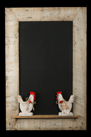 reclaimed: Vintage Easter chicken roosters with red hearts chalkboard blackboard in reclaimed old wooden frame isolated on black with copy space