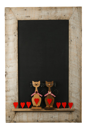 Vintage valentines love cats with red hearts chalkboard blackboard in reclaimed old wooden frame isolated on white with copy space Stock Photo