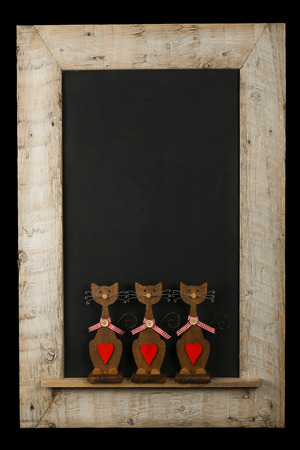 Reclaimed: Vintage valentines love cats with red hearts chalkboard blackboard in reclaimed old wooden frame isolated on black with copy space