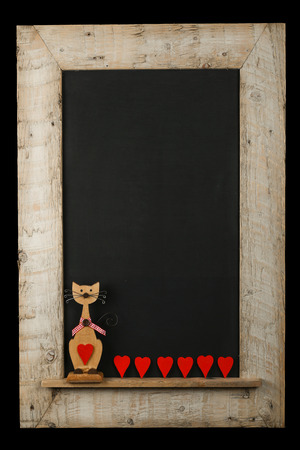 reclaimed: Vintage valentines love cat with red hearts chalkboard blackboard in reclaimed old wooden frame isolated on black with copy space Stock Photo