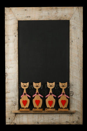 Vintage valentines love cats with red hearts chalkboard blackboard in reclaimed old wooden frame isolated on black with copy space photo