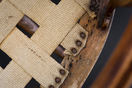 inlays: Old antique arm chair with inlays for wood repair and upholstery restoration Stock Photo