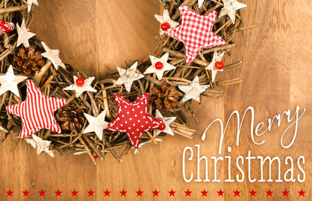 gingham: Merry Christmas message, handmade wreath decoration Shabby Chic white wooden stars with red gingham fabric pattern over wooden background - retro style design