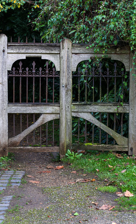 allegory painting: Entrance of a graveyard with a closed wooden frame and wrought-iron gate at Holywell Cemetery, Oxford, UK. Stock Photo