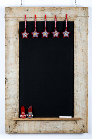 reclaimed: Chalkboard blackboard with red grey fabric stars and small children winter puppet nordic decoration restaurant vintage menu design on painted reclaimed wooden frame on white background with copy space Stock Photo