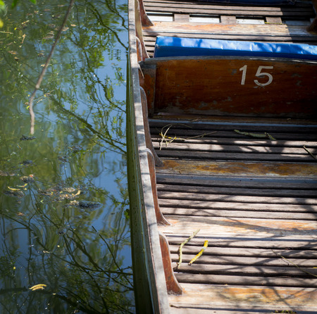 punt: Oxford punt number 15 with blue seats on the river Cherwell. Oxfordshire, England