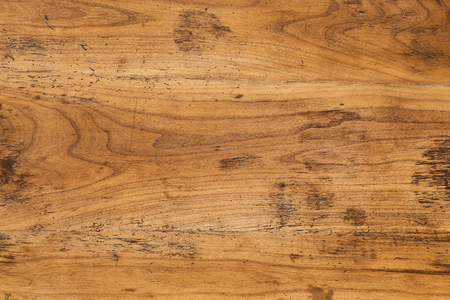 full of holes: Old antique mahogany wooden table top background full of wood worm holes Stock Photo