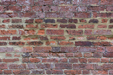 Close up of an old dark moody grungy brick wall background Stock Photo