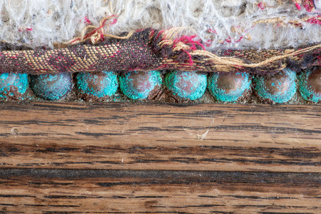 oxidising: Turquoise blue patina on old copper upholstery nails studs on antique oak chair seat