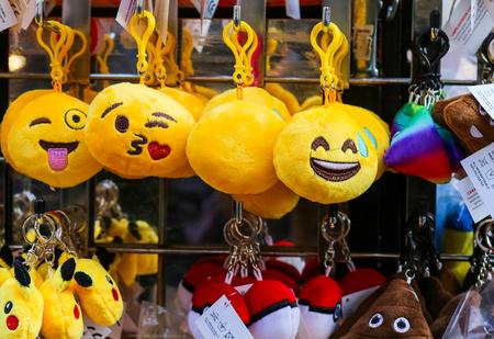Cornmarket Street, Oxford, United Kingdom, January 22, 2017: Emoji expressions as cushions key rings for sale on Cornmarket Street, Oxford city centre, England
