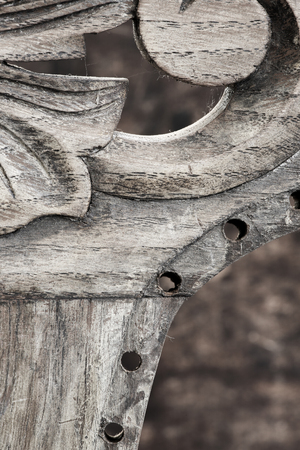 Broken old dusty carved wooden detail on old weathered oak antique chair