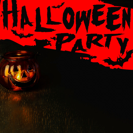 Halloween party invitation concept, pumpkin head bowl lantern on dark background with copy space