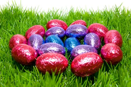 Circle of colored easter eggs in the grass  photo