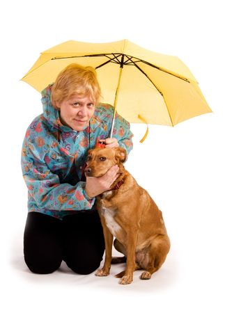 Woman sitting with her dog under an umbrella  photo