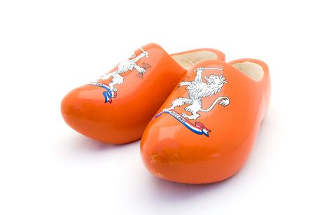 Orange Dutch wooden shoes on a white background photo