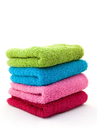 Stack of colorful towels on a white background  photo