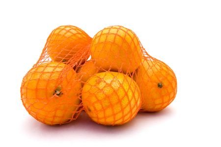 Net with fresh mandarines on a white background  photo