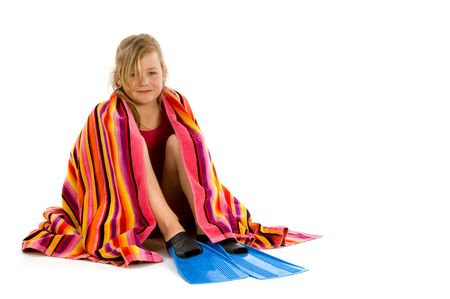 Girl wrapped in a towel sitting with her flippers on  photo
