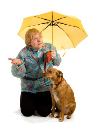Woman with her dog seeing whether it rains Stock Photo - 5077308