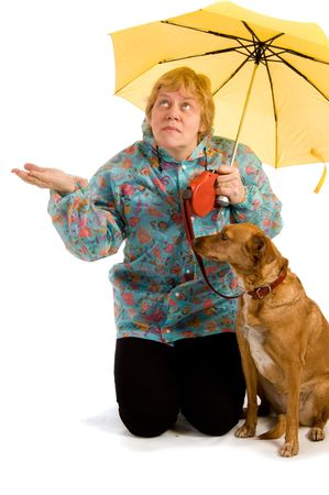 Woman with her dog seeing whether it rains Stock Photo - 5403528