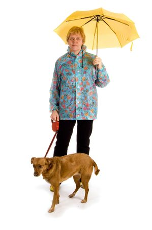Woman walking with her dog under an umbrella photo